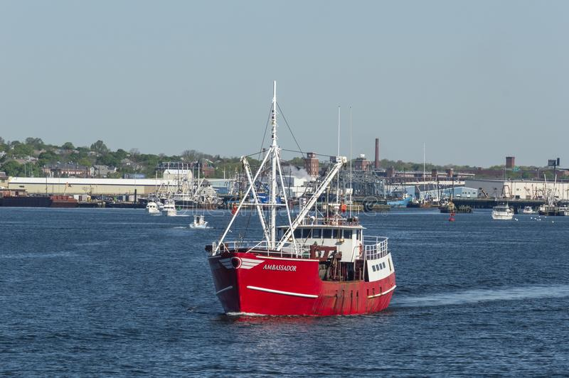 Commercial fishing boat Ambassador leaving port. New Bedford, Massachusetts, USA - May 21, 2018: Eastern rig commercial fishing vessel Ambassador leaving New royalty free stock images