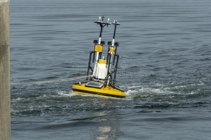 Wind monitoring buoy under tow stock image