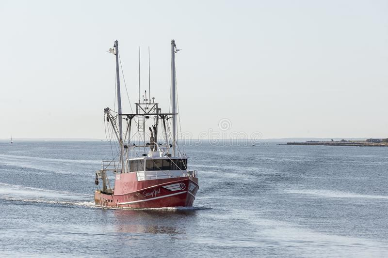 Commercial fishing boat Sassy Girl coming out of Buzzards Bay on way into New Bedford. New Bedford, Massachusetts, USA - September 21, 2018: Commercial fishing royalty free stock photography