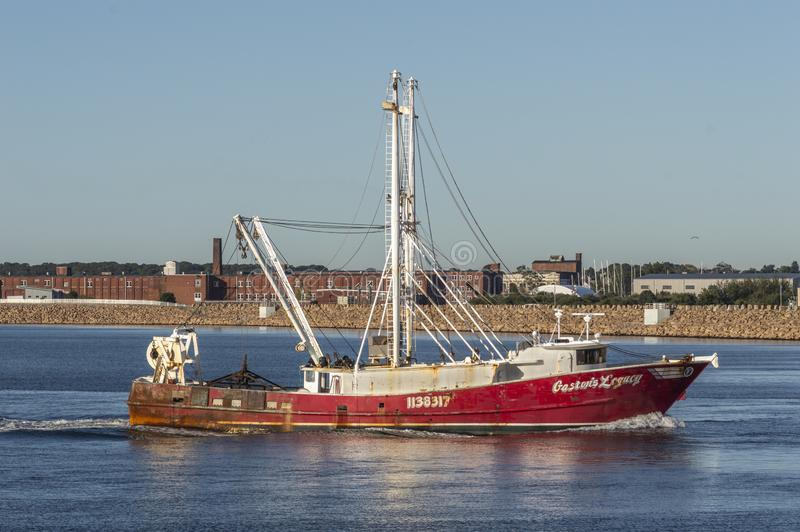 Commercial fishing boat Gaston`s Legacy nearing New Bedford. New Bedford, Massachusetts, USA - September 27, 2019: Scalloper Gaston`s Legacy, hailing port New royalty free stock photo