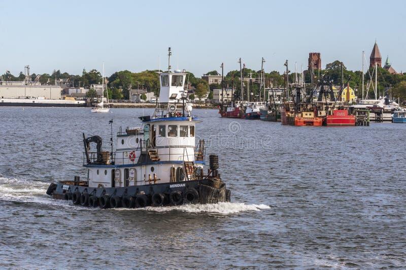 Tug Meridian leaving New Bedford. New Bedford, Massachusetts, USA - September 5, 2019: Tug Meridian, hailing port Boston, Massachusetts, passing Fairhaven stock images