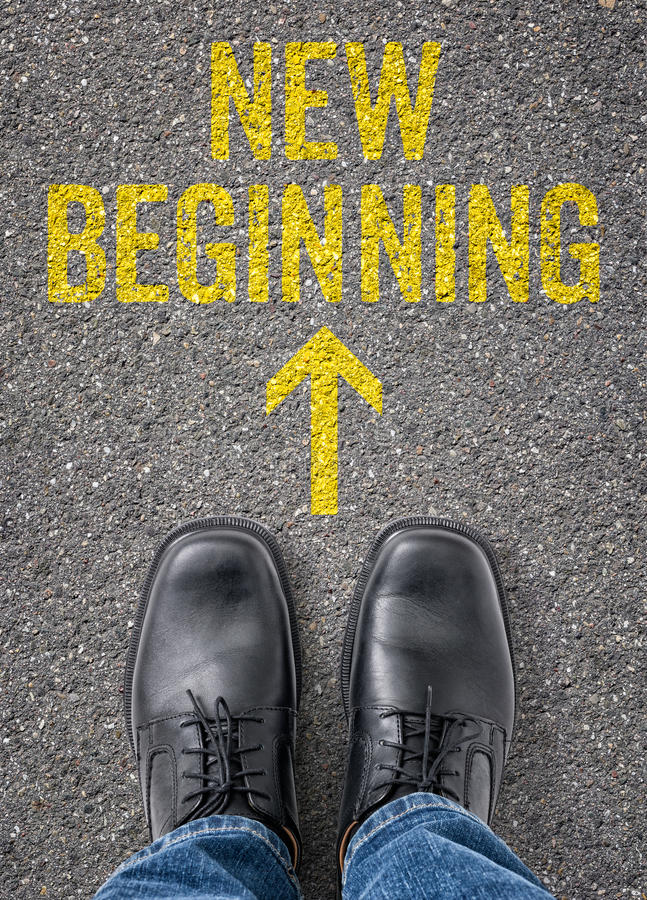 New beginning. Text on the floor - New beginning stock photography