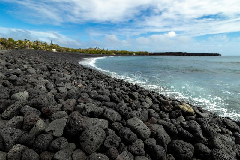 New black sand beach at Isaac Hale Beach Park created by 2018 eruption and lava flow of Kilauea volcano on the Big Island of Hawai royalty free stock image
