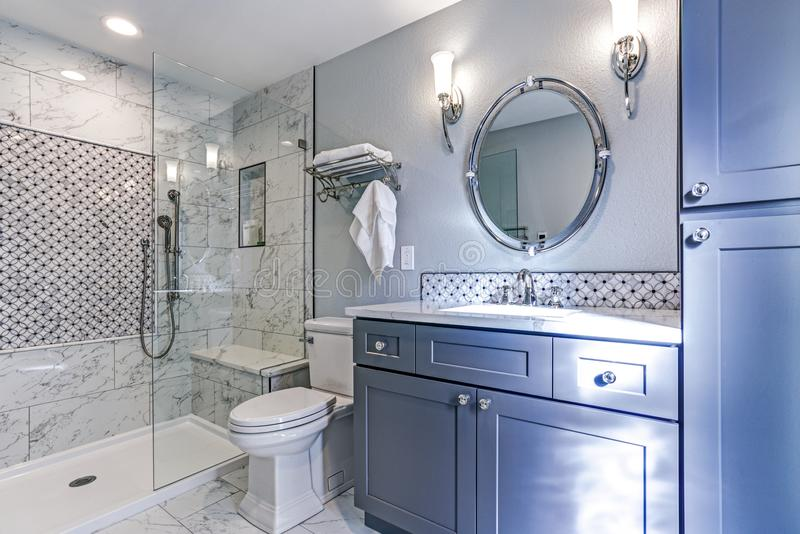 New blue bathroom design with Marble shower Surround stock photos