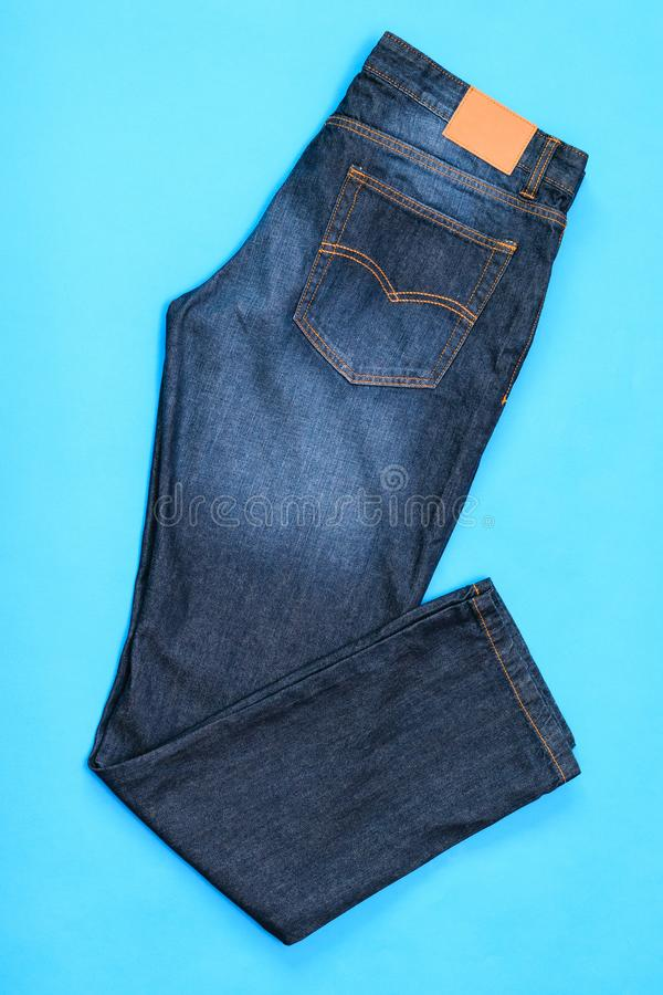 New blue men jeans on blue background. stock photo