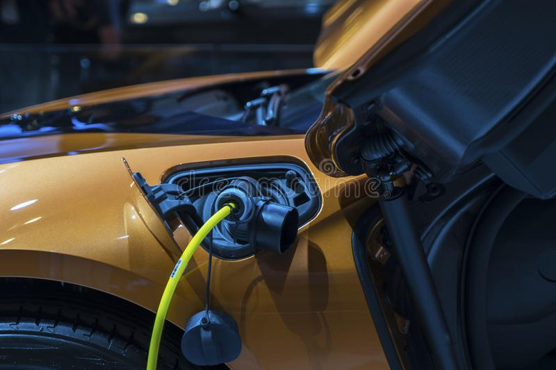 New BMW i8 Roadster car doing charge. Tangerang - Indonesia. August 13, 2018: New BMW i8 Roadster car doing charge at Gaikindo Indonesia International Auto Show stock image