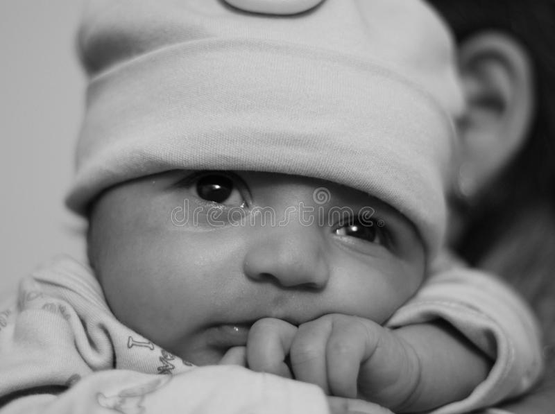 New born asian baby girl on her mother's shoulder stock photos