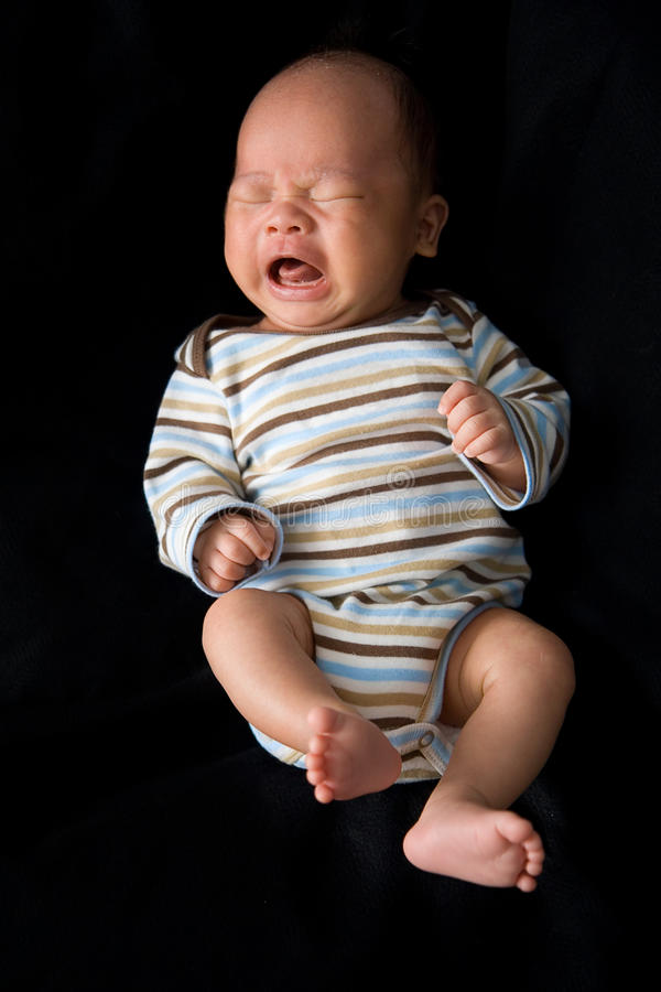 New Born Baby Crying. Isolate with a black background royalty free stock images