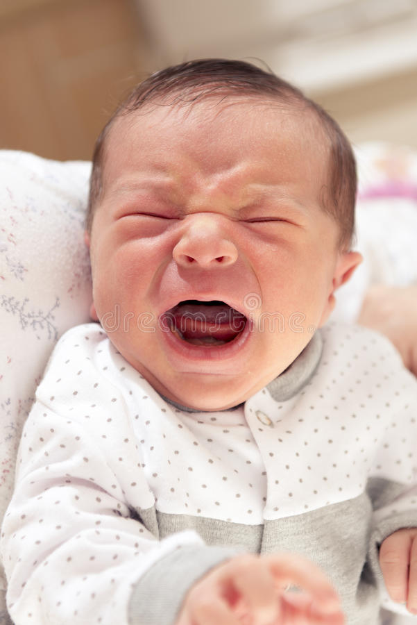 New Born Baby Crying. Cute New Born Baby Crying Loudly with Facial Gesture stock photography