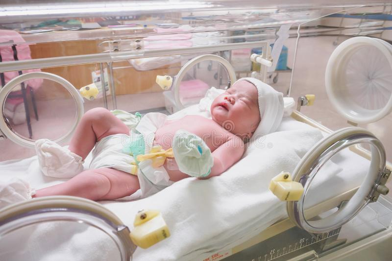 New born baby infant sleep in the incubator at hospital. Room stock images