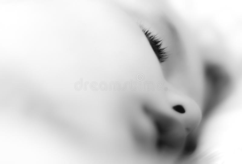 New born baby sleeping. Black and white picture with a new born baby sleeping stock image