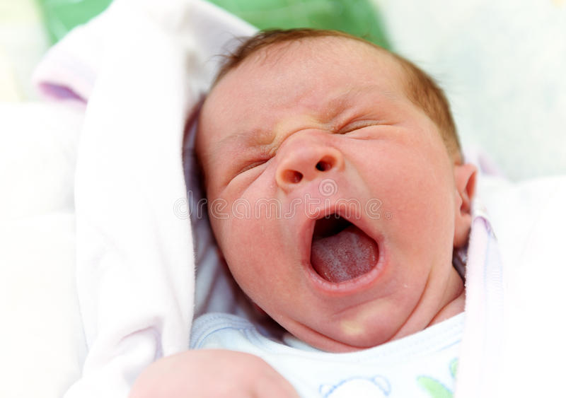 New Born Baby Yawning royalty free stock images