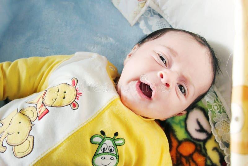 Baby girl yawning royalty free stock photography