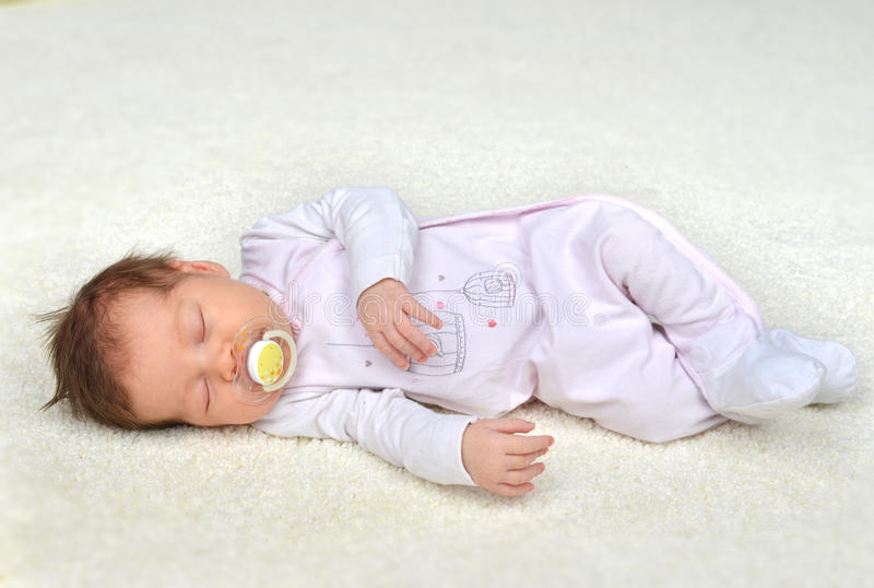 New born infant child baby girl sleeping royalty free stock photography