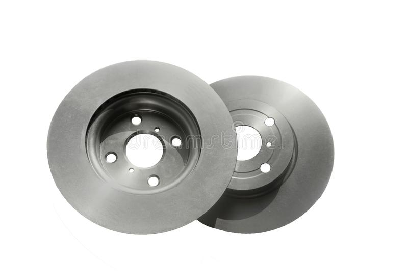 New Brake discs isolated on white for transportation cars concept.  royalty free stock images