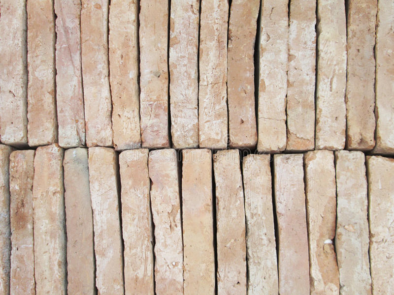 New brick pavers stacked in rows like wall. Store of bricks ready for building or sale. Construction materials and outdoor sto. New red brick pavers stacked in royalty free stock photography