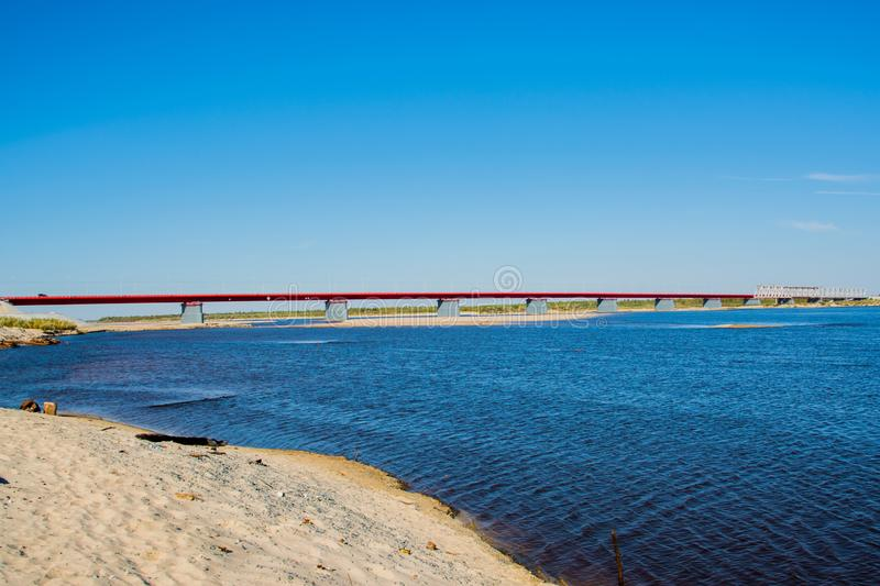 The new bridge over the river Nadym. Yamal. Arctic nature. Beutifull landscape stock photography