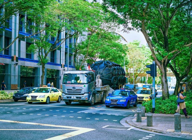 New Bridge street with car traffic Singapore. Singapore, Singapore - March 1, 2016: New Bridge street with car traffic, in Singapore royalty free stock photo