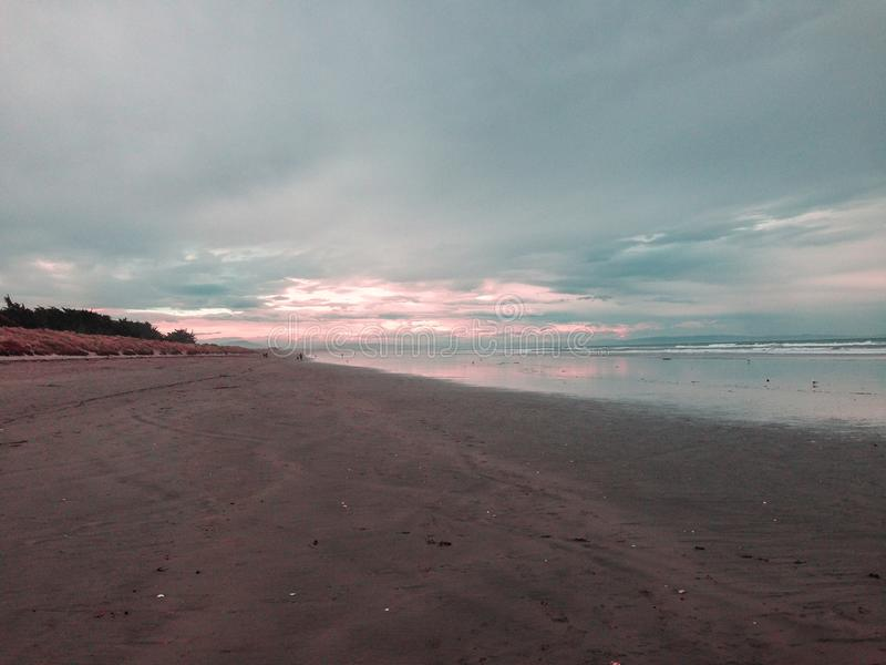 New Brighton beach at sunset, Canterbury, South Island, New Zealand.  stock image