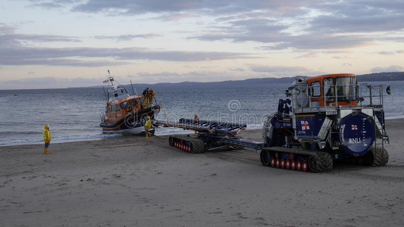 New British lifeboat landing on Exmouth beach in Devon UK after sea trials. This boat is the latest most agile in the RNLI`s fleet stock photography