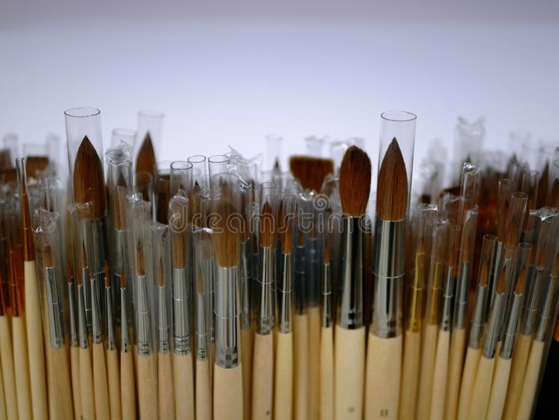 New brushes for painting of different sizes and shapes on display. brushes with wooden handle. goods for artists. products for ink. S and paints stock images
