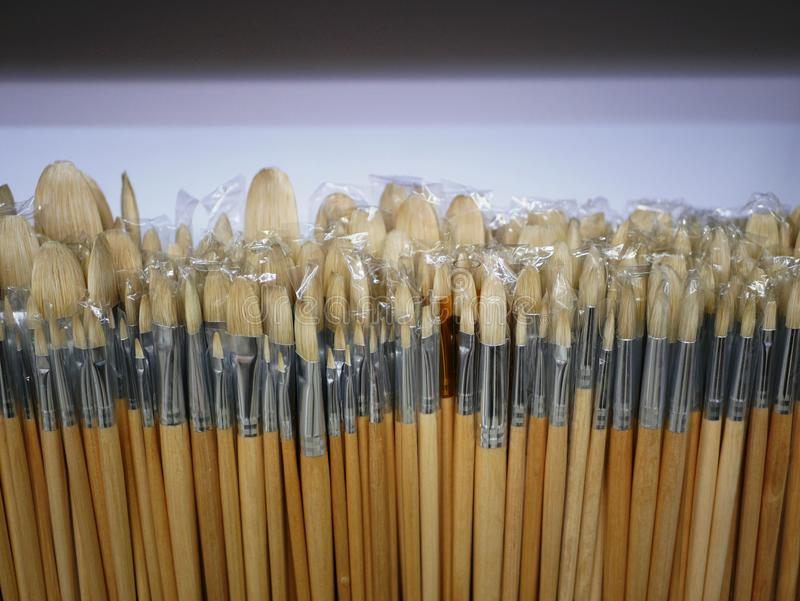 New brushes for painting of different sizes and shapes on display. brushes with wooden handle. goods for artists. products for ink. S and paints stock photos