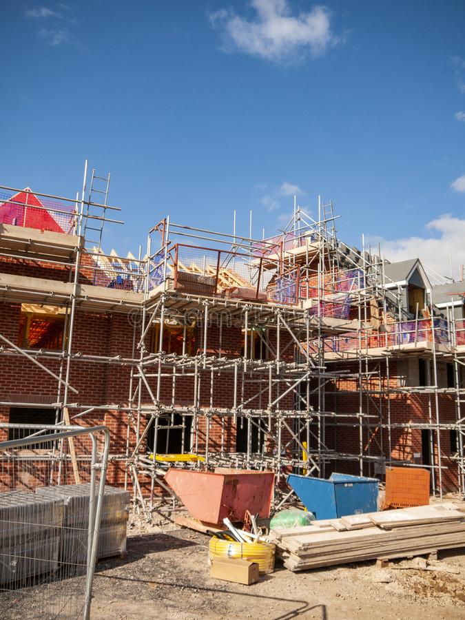 New build homes in scaffolding on an housing estate in Cheshire UK. New build homes under construction on an new housing estate in Cheshire England United royalty free stock photo