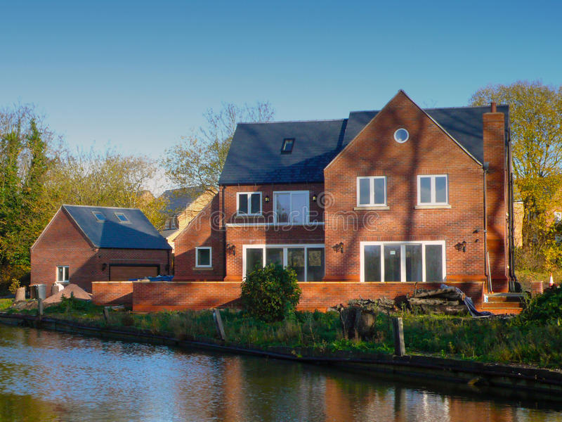 New build house on canal side UK stock photos