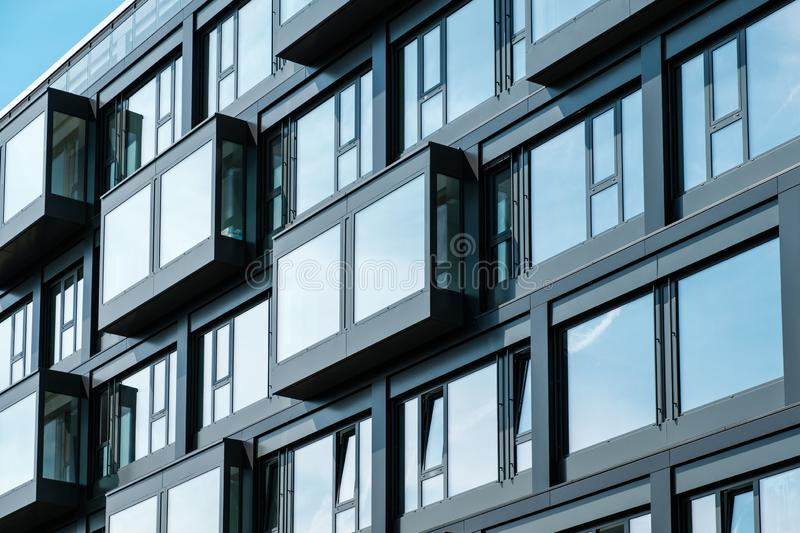 New building facade , windows on apartment house exterior royalty free stock photo