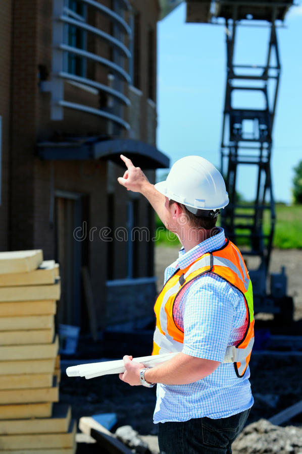 New Building Inspection. Project Manager Checking Out A New Building Construction royalty free stock image