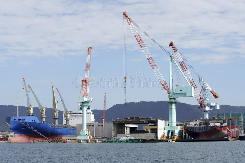 New building ship in shipyard. Against a blue sky stock photo