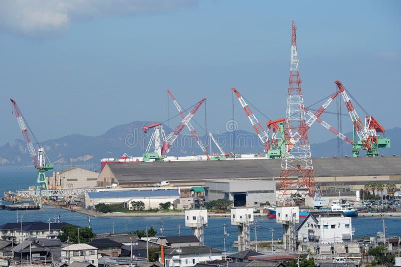 New building ship in shipyard. Against a blue sky stock photos