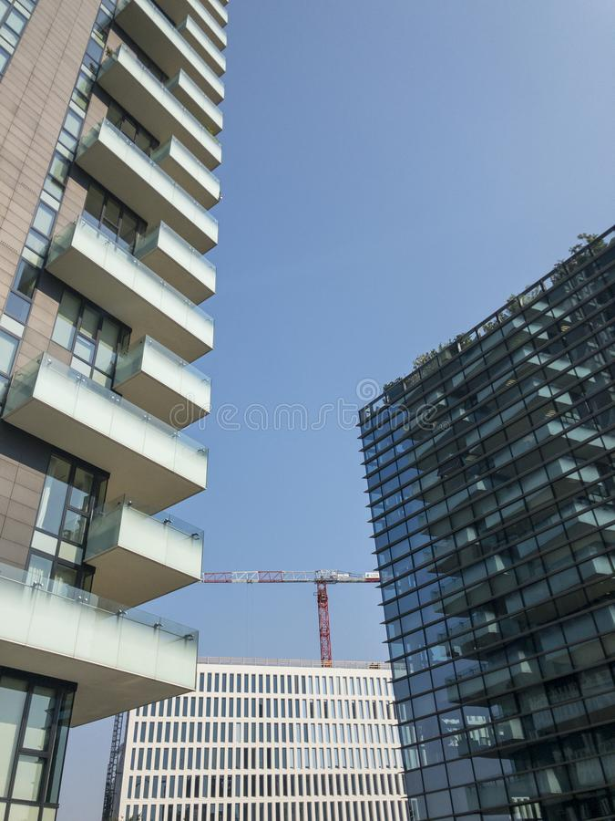 New buildings in Milan, construction sites and residential buildings, the new Milan. Italy. ousing solutions. Solaria Tower. New buildings in Milan, construction stock images