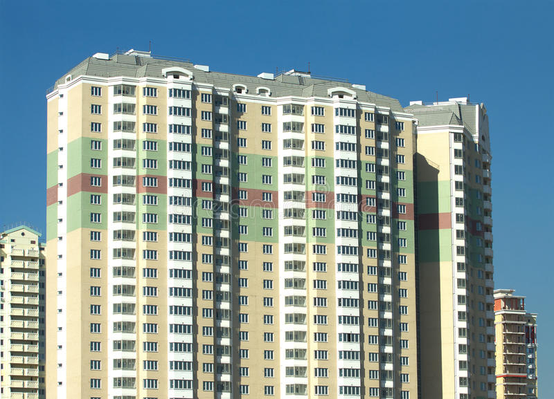 New built modern apartment building of brick with a clear blue sky stock images