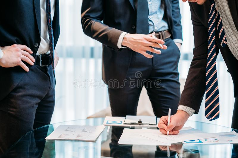 Business partnership man sign contract shake hands stock images