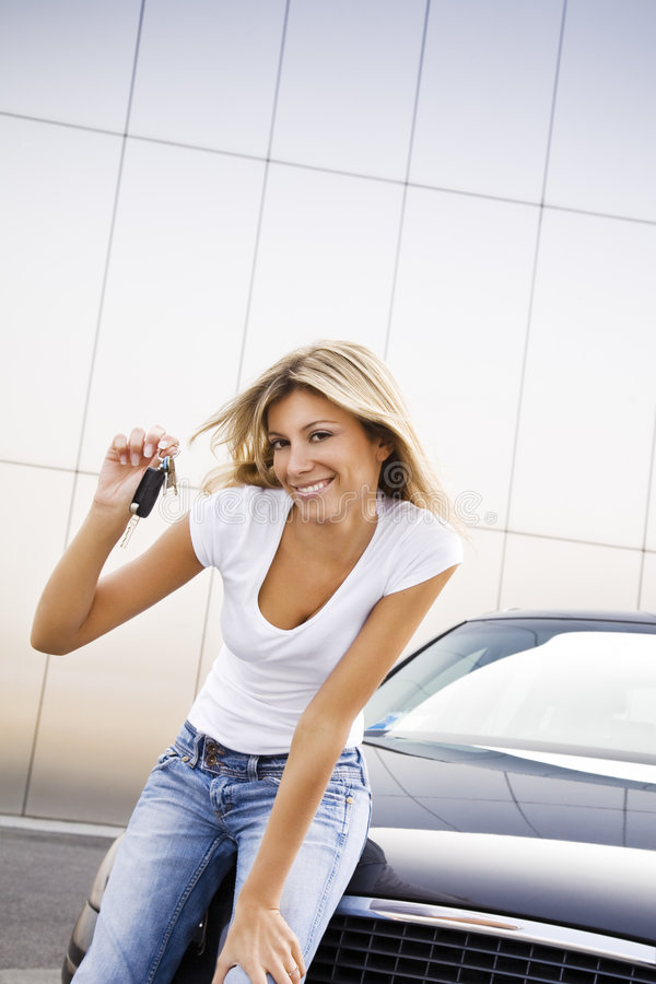 New car. Young woman holding keys to new car royalty free stock photos