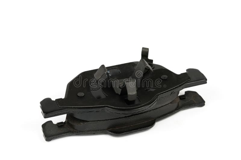 New car brake pads isolated on white. Set of spare brake pads for one wheel stock image