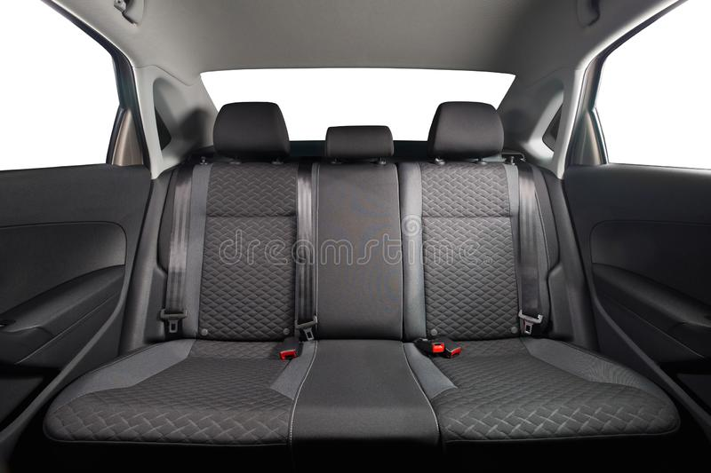 New car inside. Clean car interior. Black back seats in sedan. Car cleaning theme stock photo