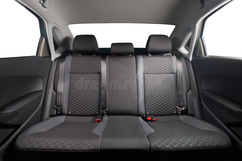 New car inside. Clean car interior. Black back seats in sedan. Car cleaning theme stock photo