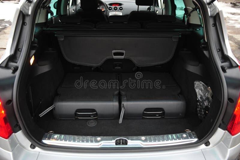 New car inside. Clean car interior. Black back seats transformer in sedan. Car cleaning theme. royalty free stock image