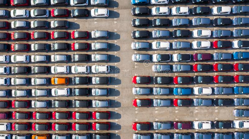 New car lined up in the port for business car import and export logistic, Aerial view royalty free stock image