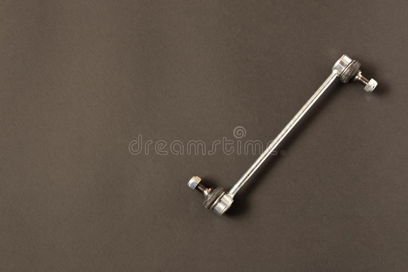 New car parts. Stabilizer link. Isolated on black background.  stock photos
