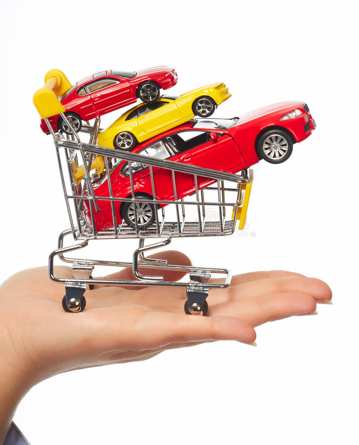 New car in shopping cart. stock photo