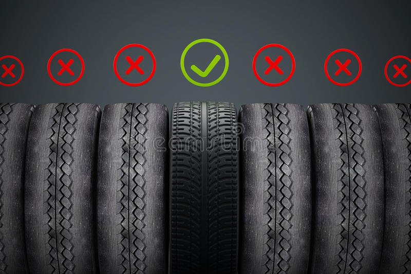 New car tire with green check mark standing out among old tires.  stock illustration