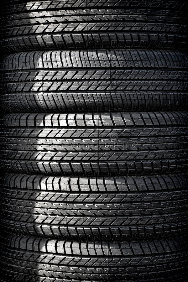New Car Tire Stack in Auto Wheel Repair Shop royalty free stock photography