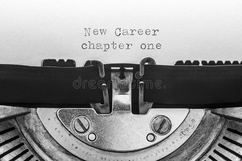 New career chapter one typed on a vintage typewriter. Macro shot stock photography
