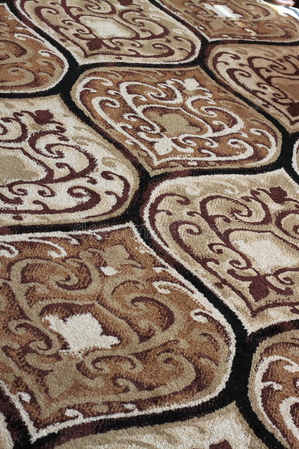 New Carpet. Beautiful new hand woven oriental carpet area rug for home interior decoration as background royalty free stock images