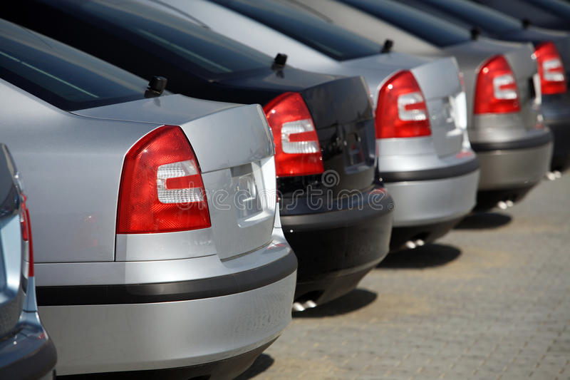 New cars. In dealership; rear view stock photos