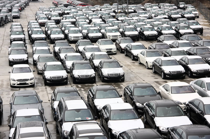 New cars in stock at port. A photo of new cars in a warehouse at a port stock images