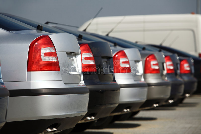 New cars. In dealership; rear view royalty free stock photo